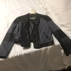 Blue cloth and black leather jacket size large.